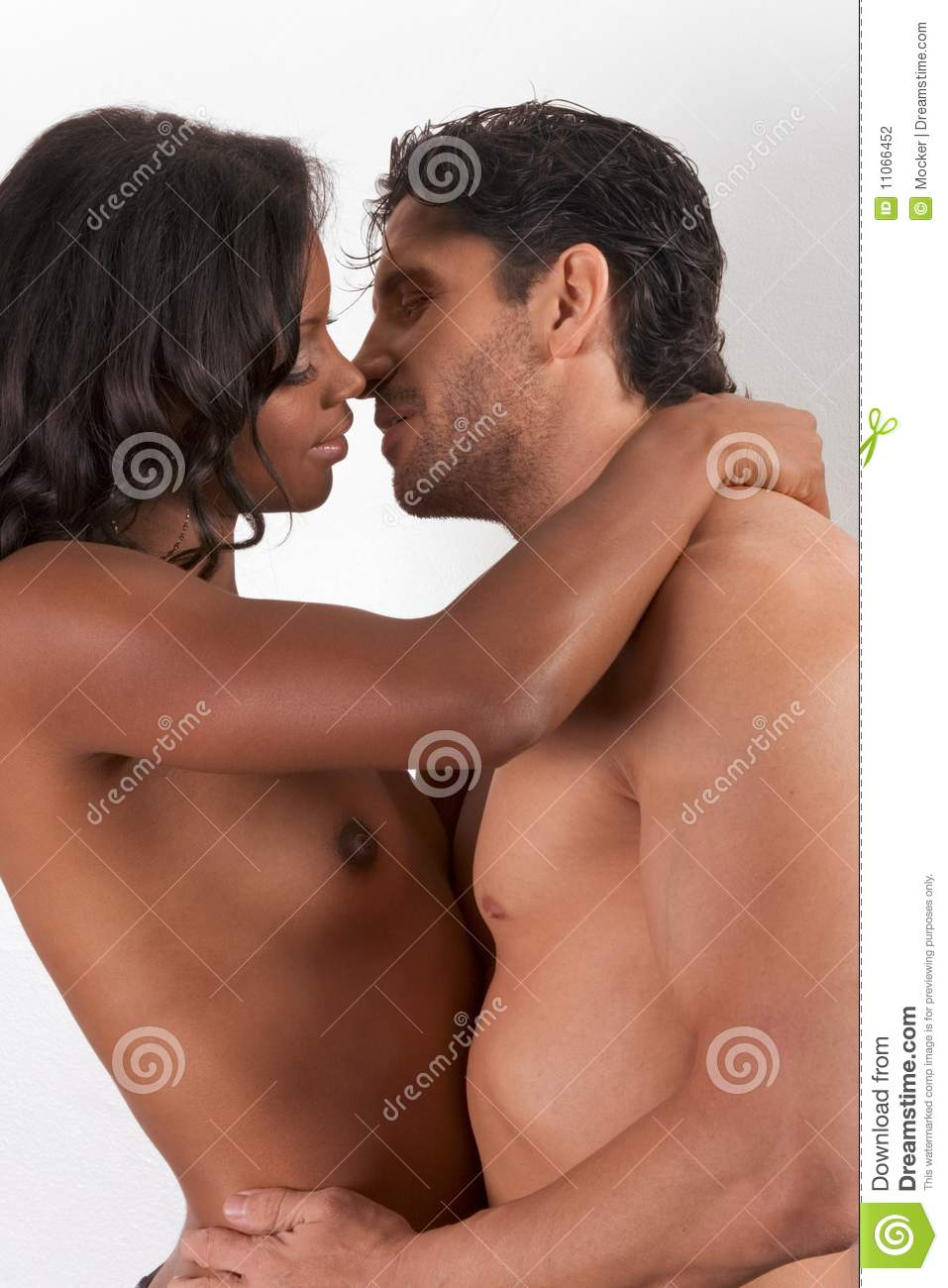 woman kissing nude man