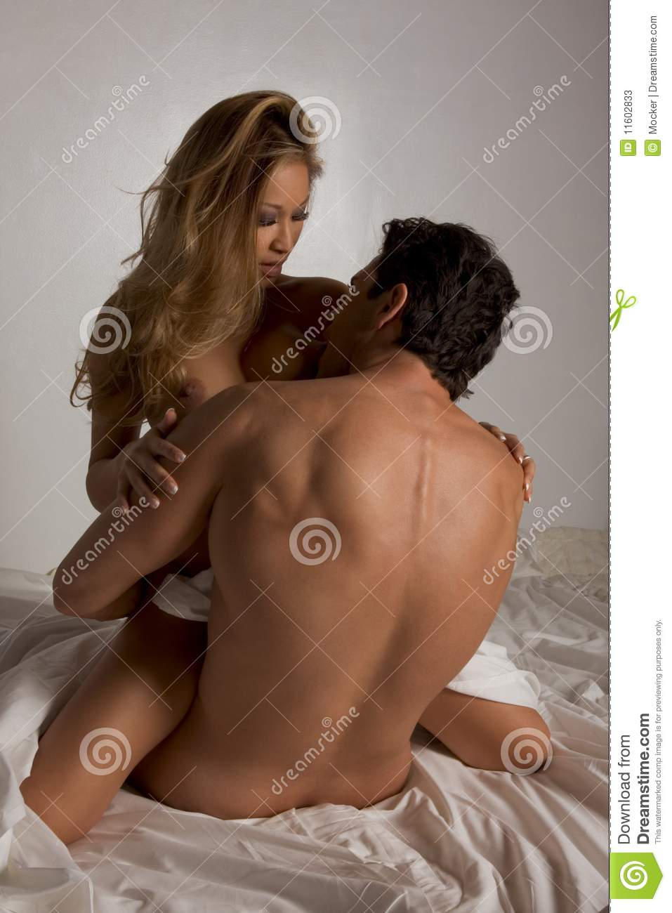 Naked men and women having sex