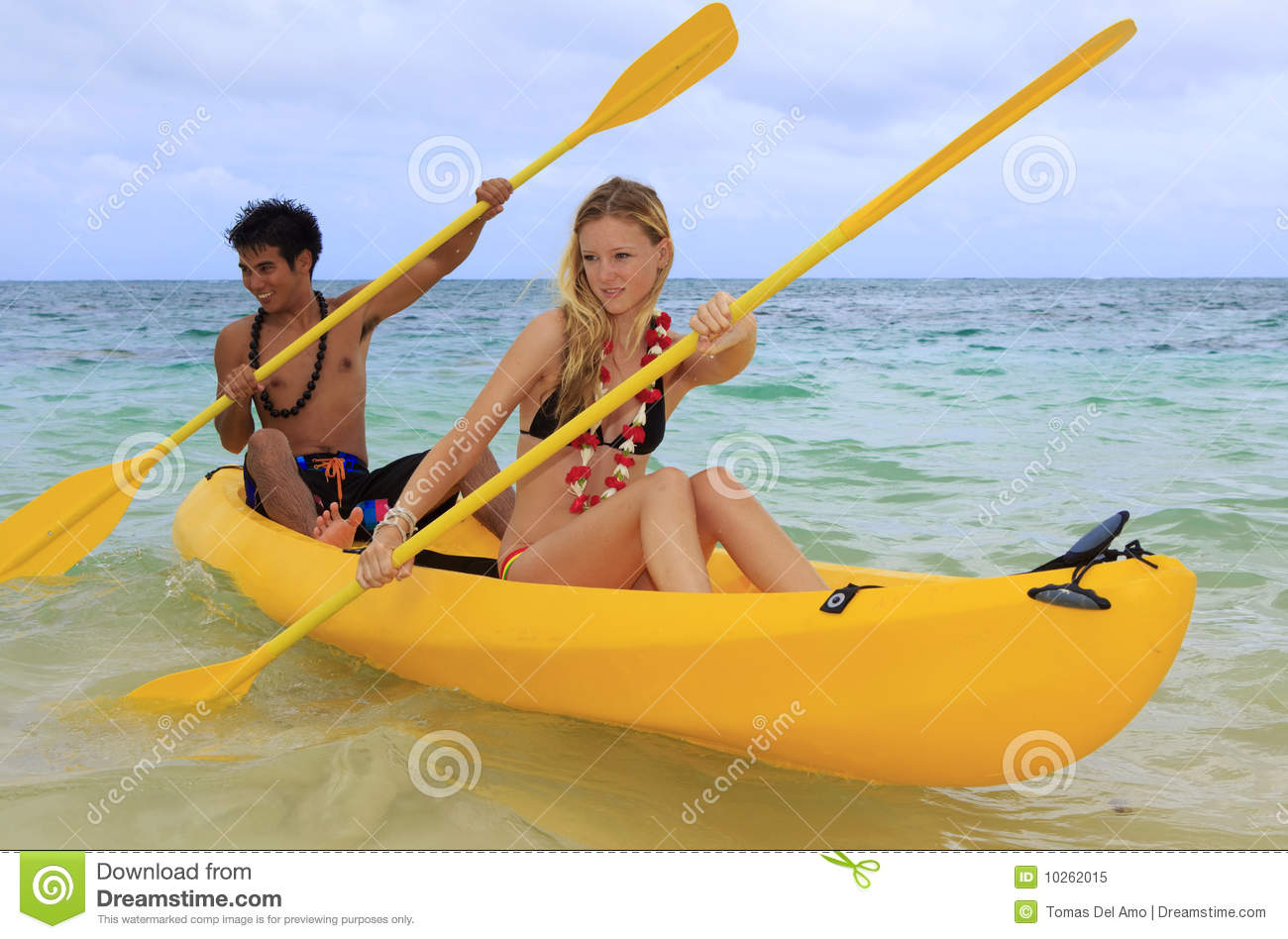 A Young Couple Paddle A Kayak In Hawaii Stock Image - Image of woman