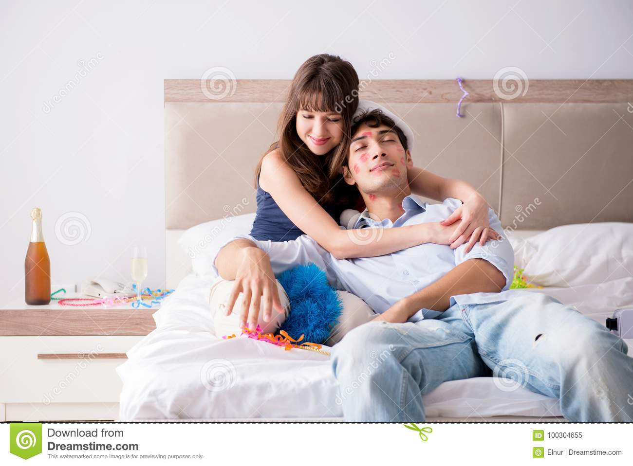 The young couple partying in the bed