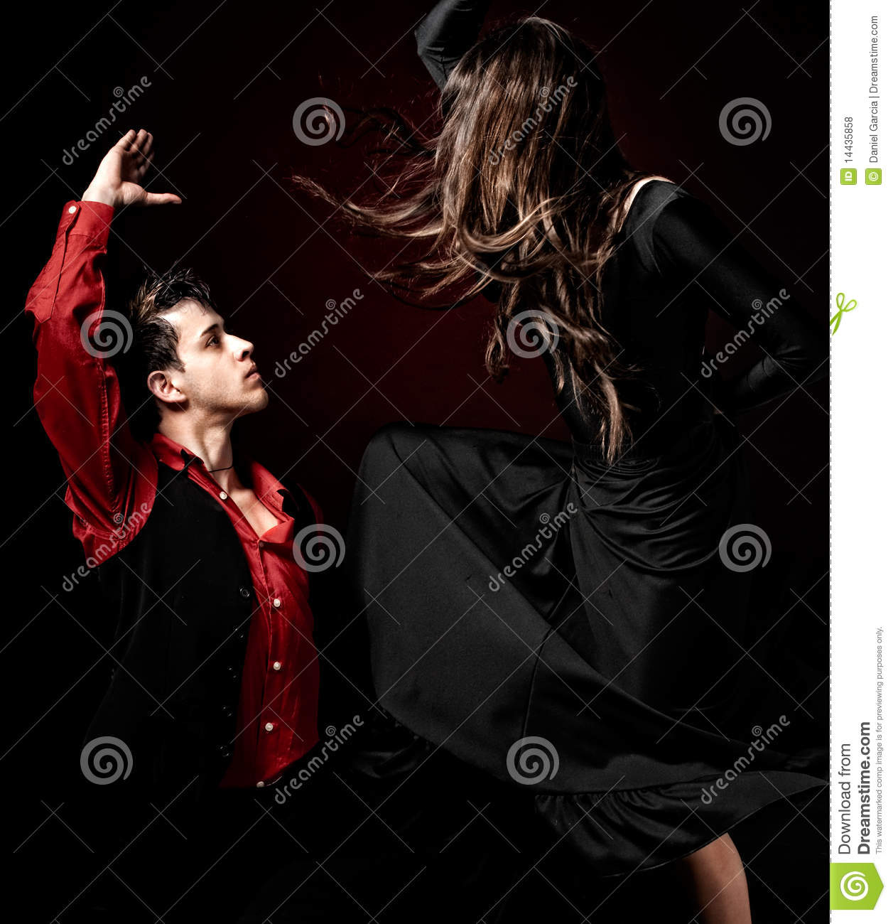 Young couple passion flamenco dancing on red ligh