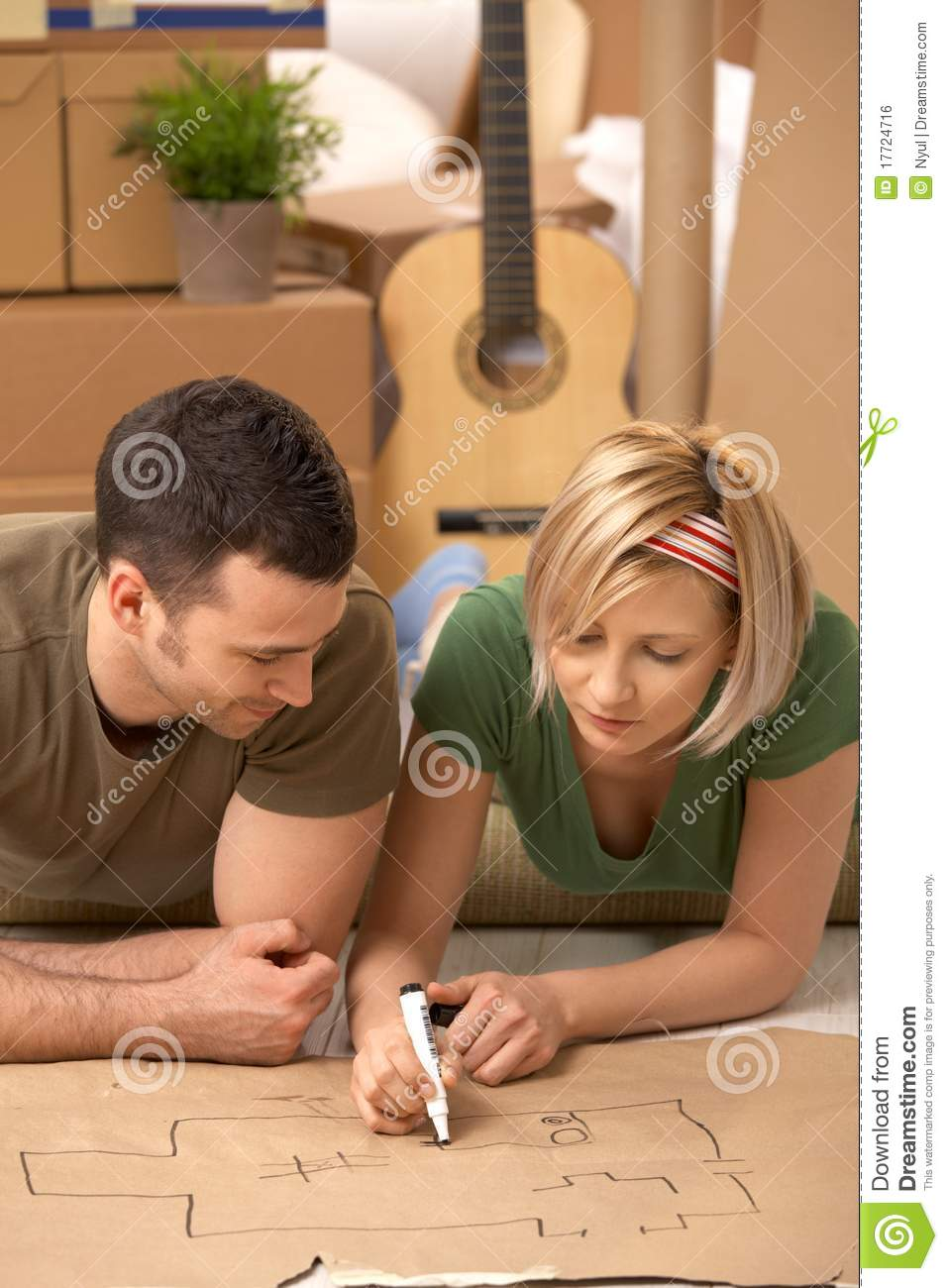 Young couple planning their new home