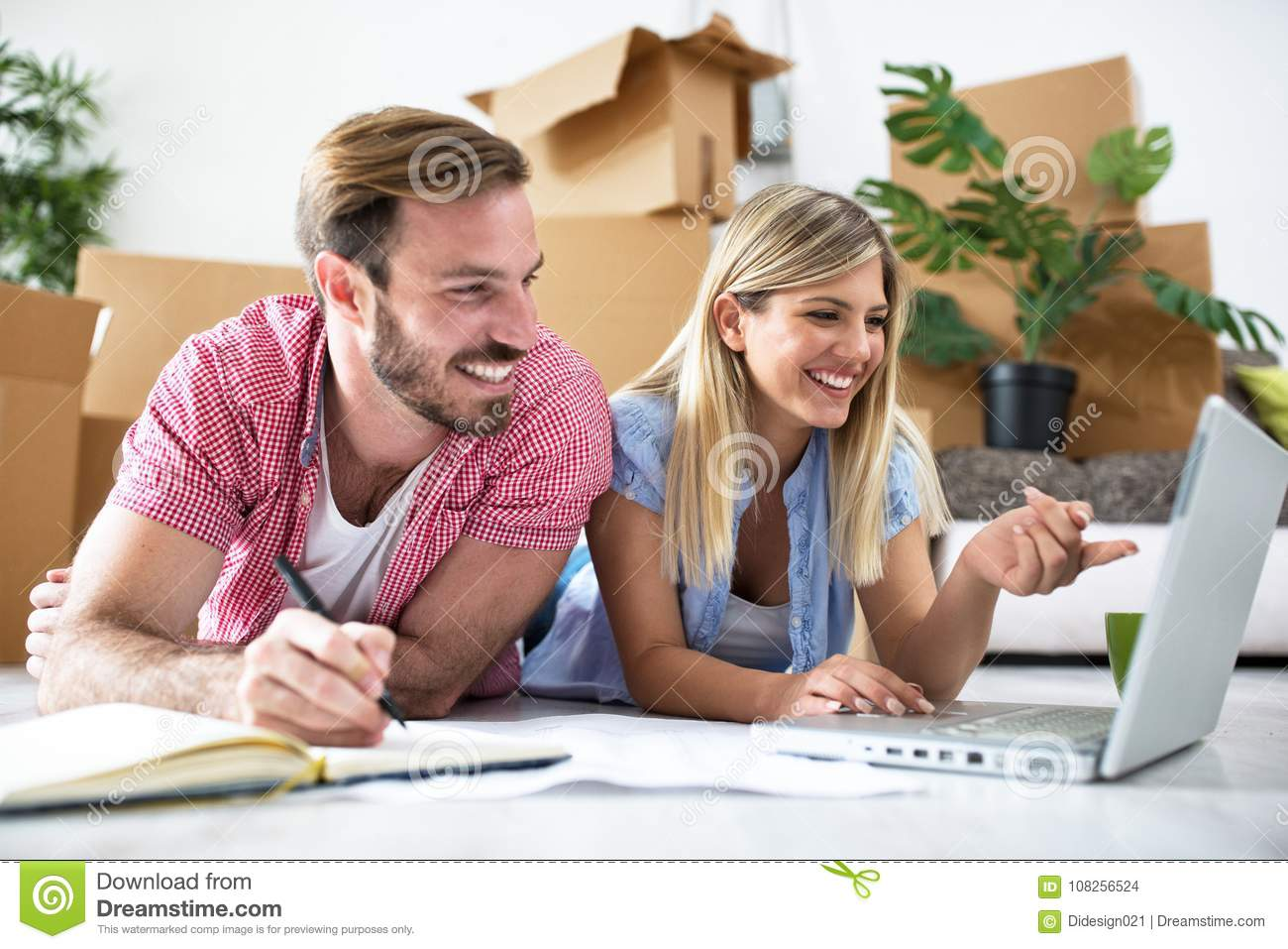 Young couple is planning to equip a new home