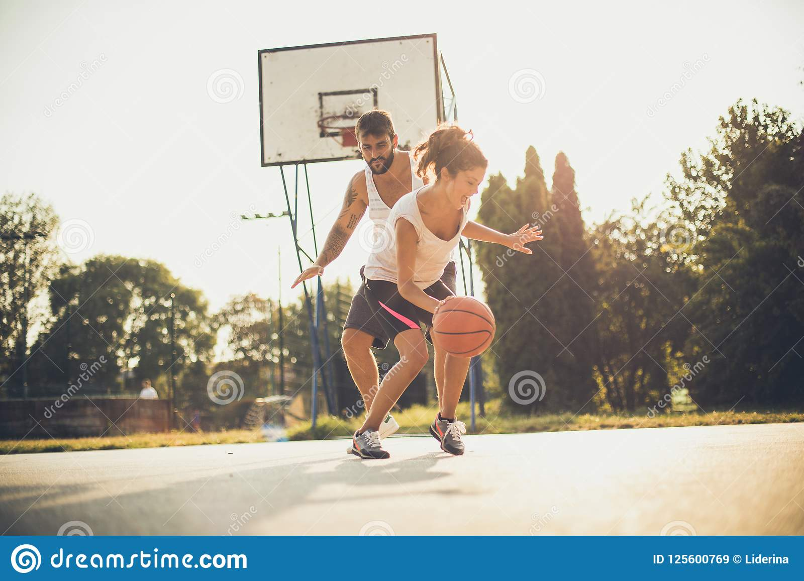 Young Couple Playing Basketball Stock Image Image Of Young