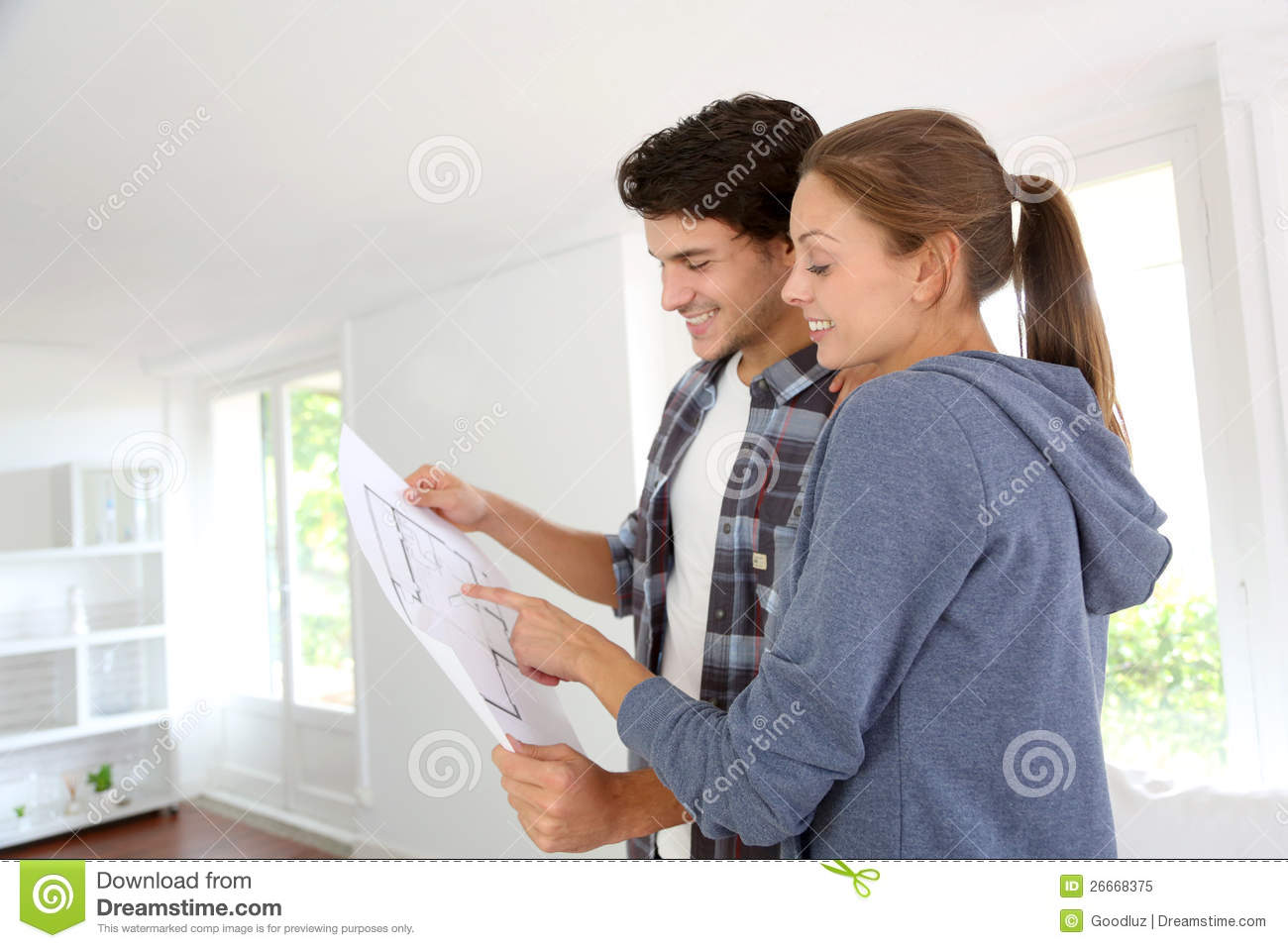 Young couple reading blueprint royalty free stock photo image 26668375 - Young couple modern homes ...