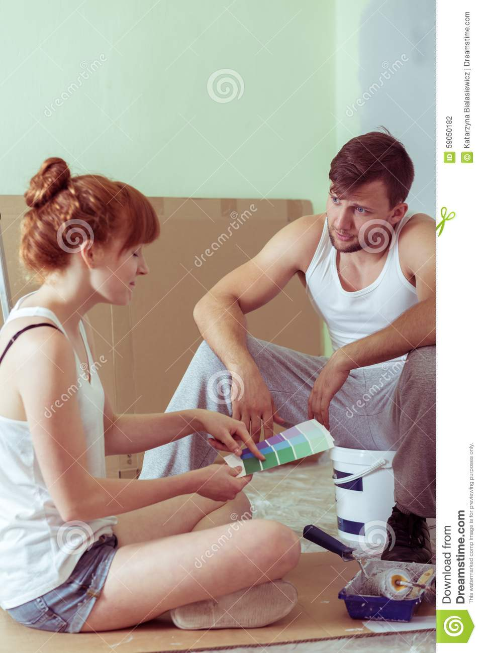 Young Couple Redecorating House