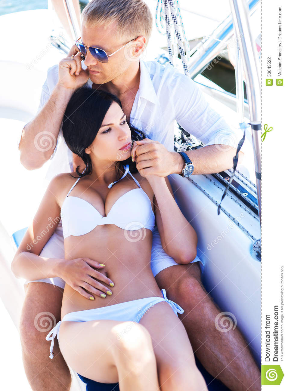 Young Couple Relacing On A Boat Stock Photo - Image of holiday, luxury: 53643522