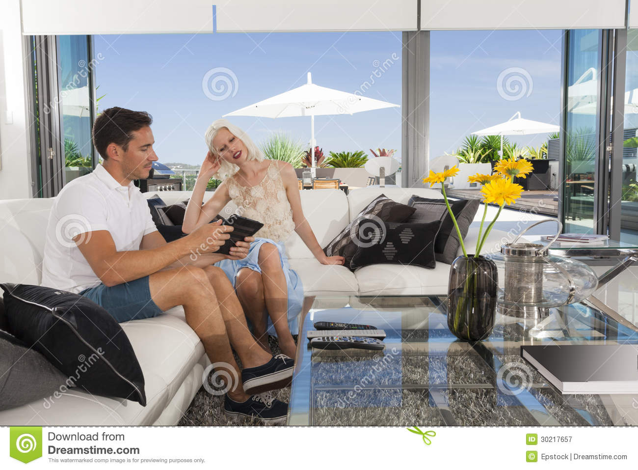 Couple in living room royalty free stock photography for Living room ideas young couples