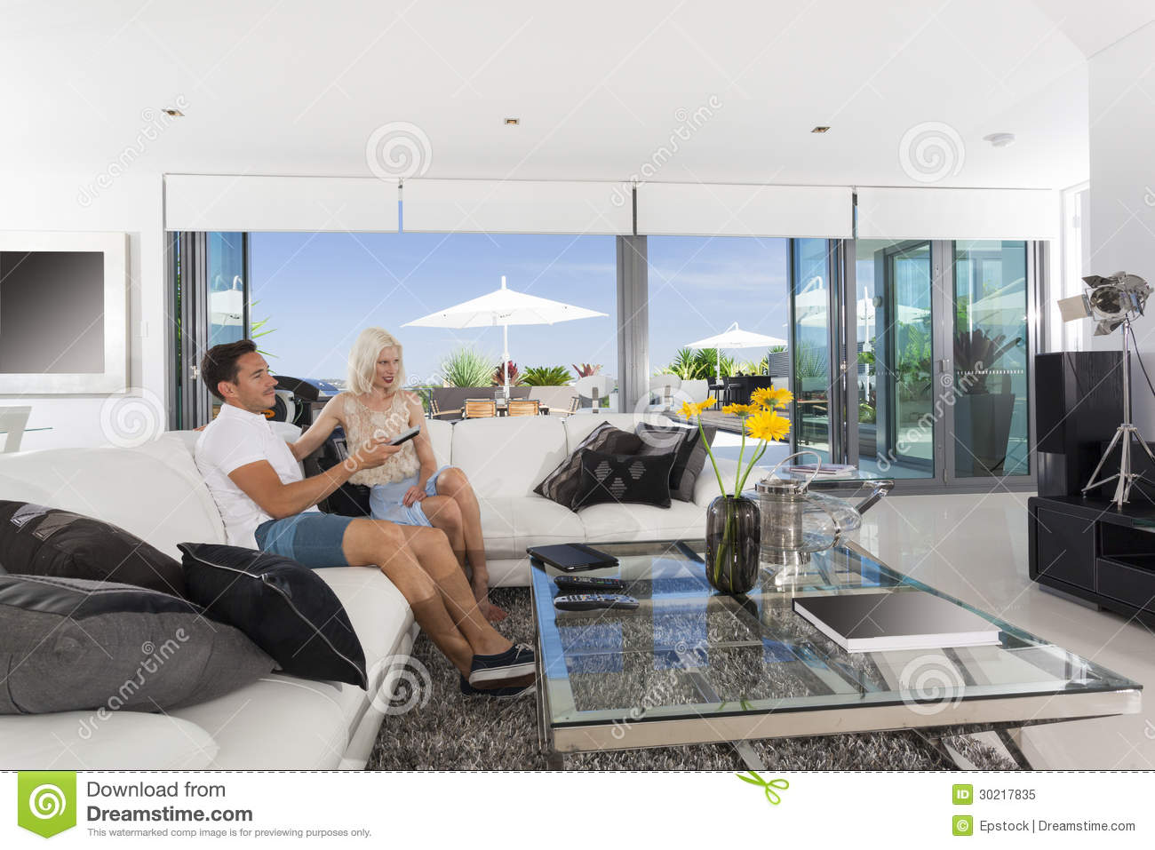 Couple in living room royalty free stock photo image for Living room ideas young couples