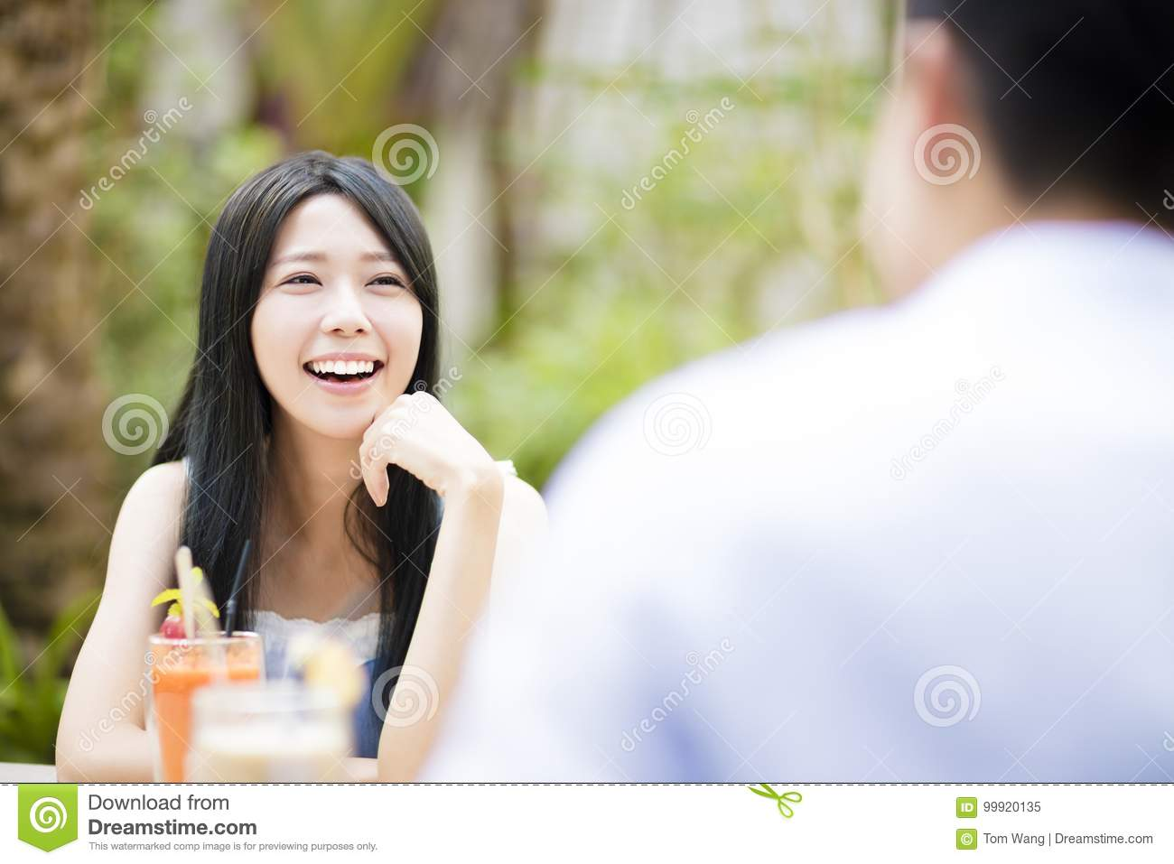 Young couple in restaurant enjoying drink