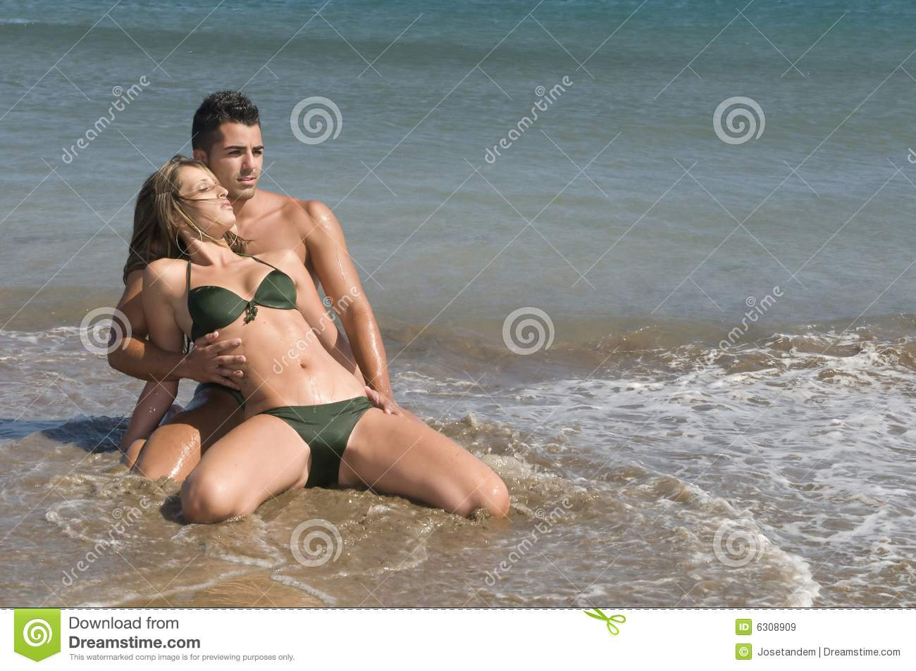 videos seaside romp with young couple.
