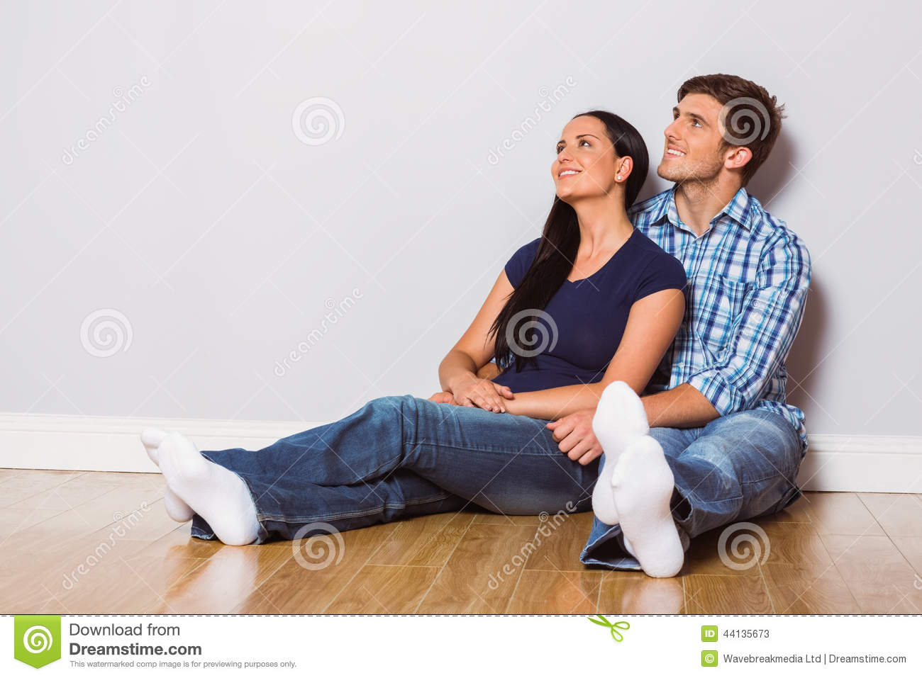 Young couple sitting on floor stock photo image 44135673 - Young couple modern homes ...