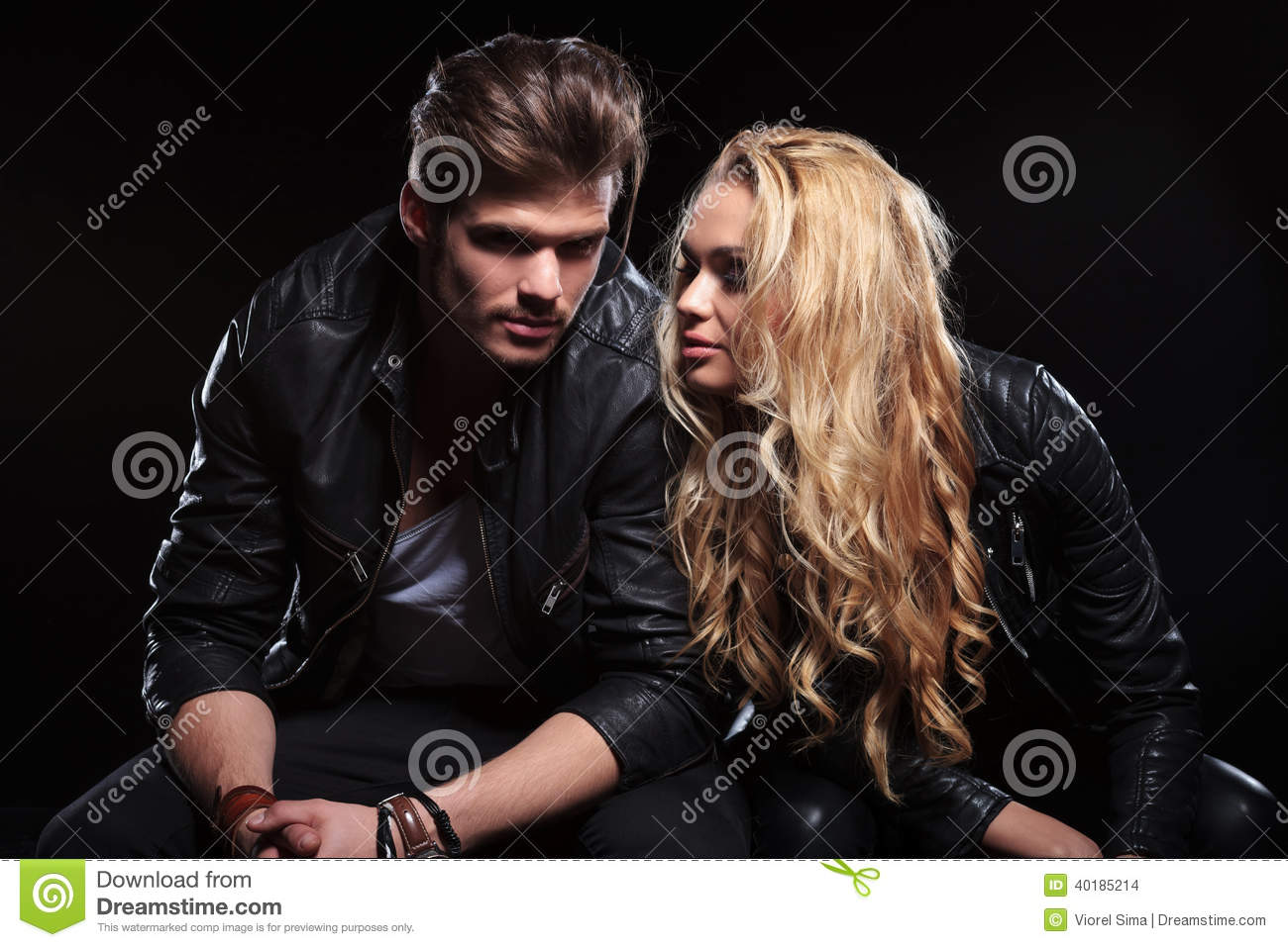 Young couple sitting next to each other