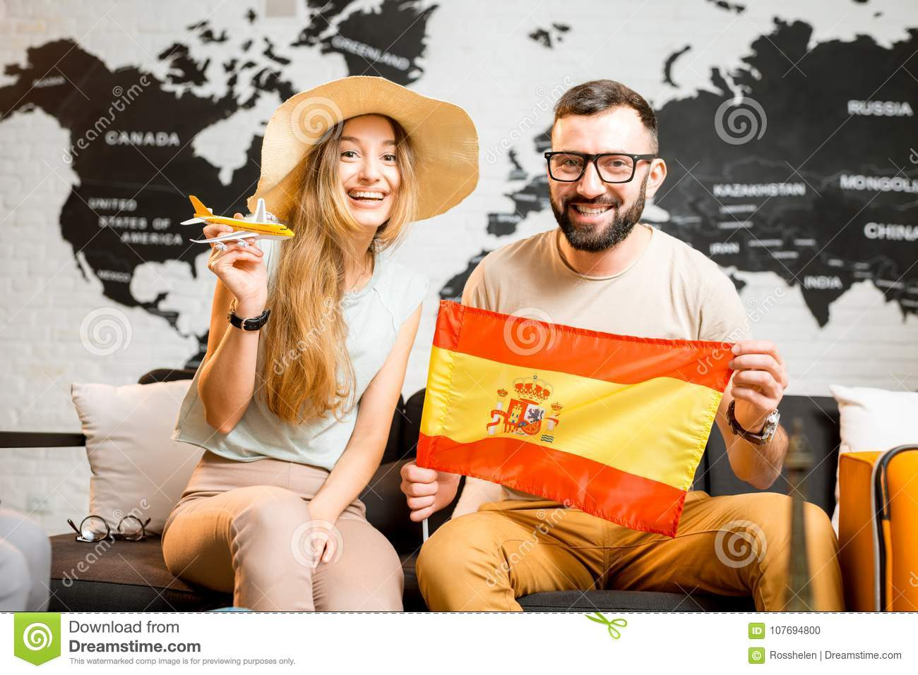 Young couple dreaming about a trip to Spain