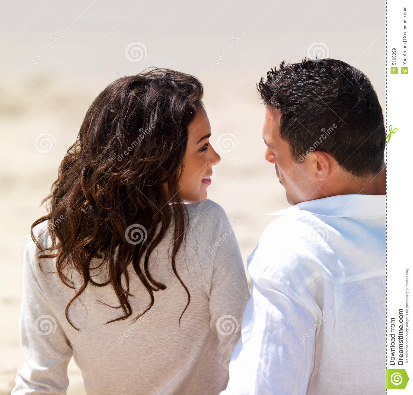 Young Couple Sitting Together Stock Image