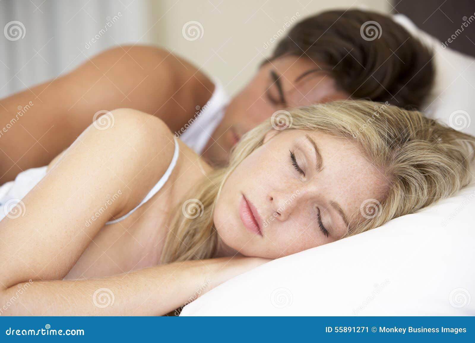 Young Couple Sleeping On Bed