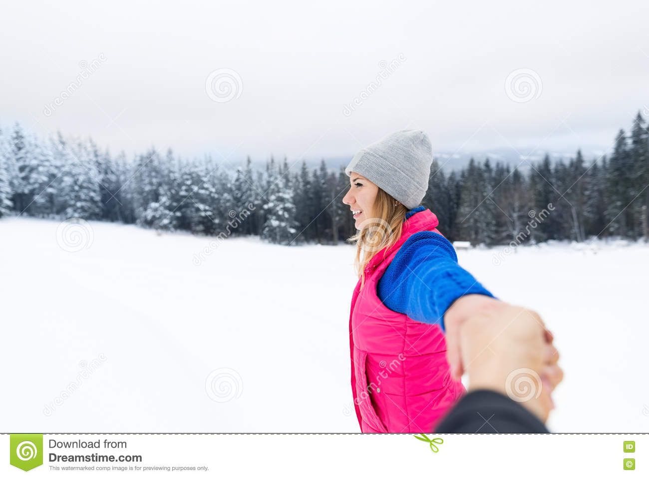 Young couple snowy mountain top woman hold hand winter for Vacation in the snow