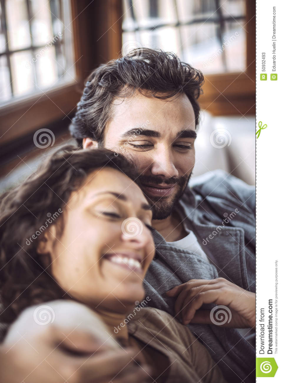 young couple on the sofa in love stock photo image 50932493. Black Bedroom Furniture Sets. Home Design Ideas
