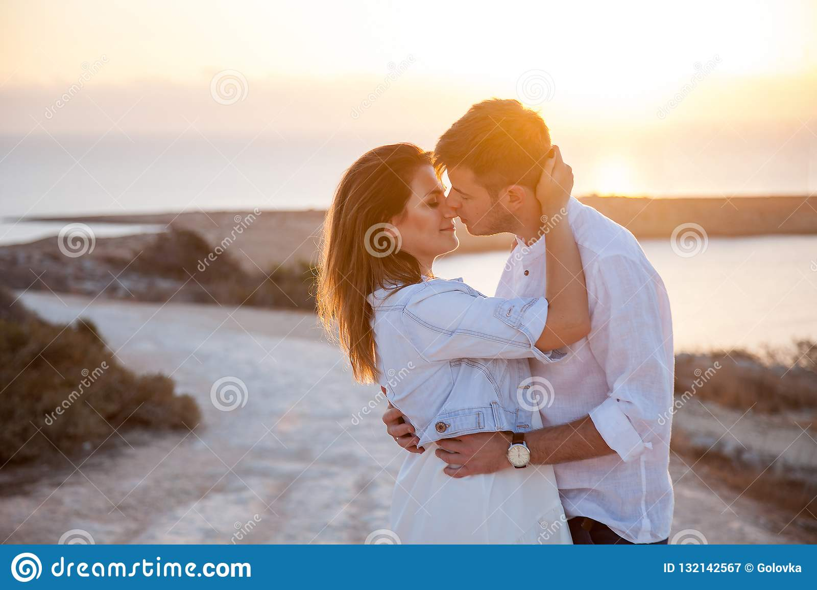 Young couple with the spectacular view on the background