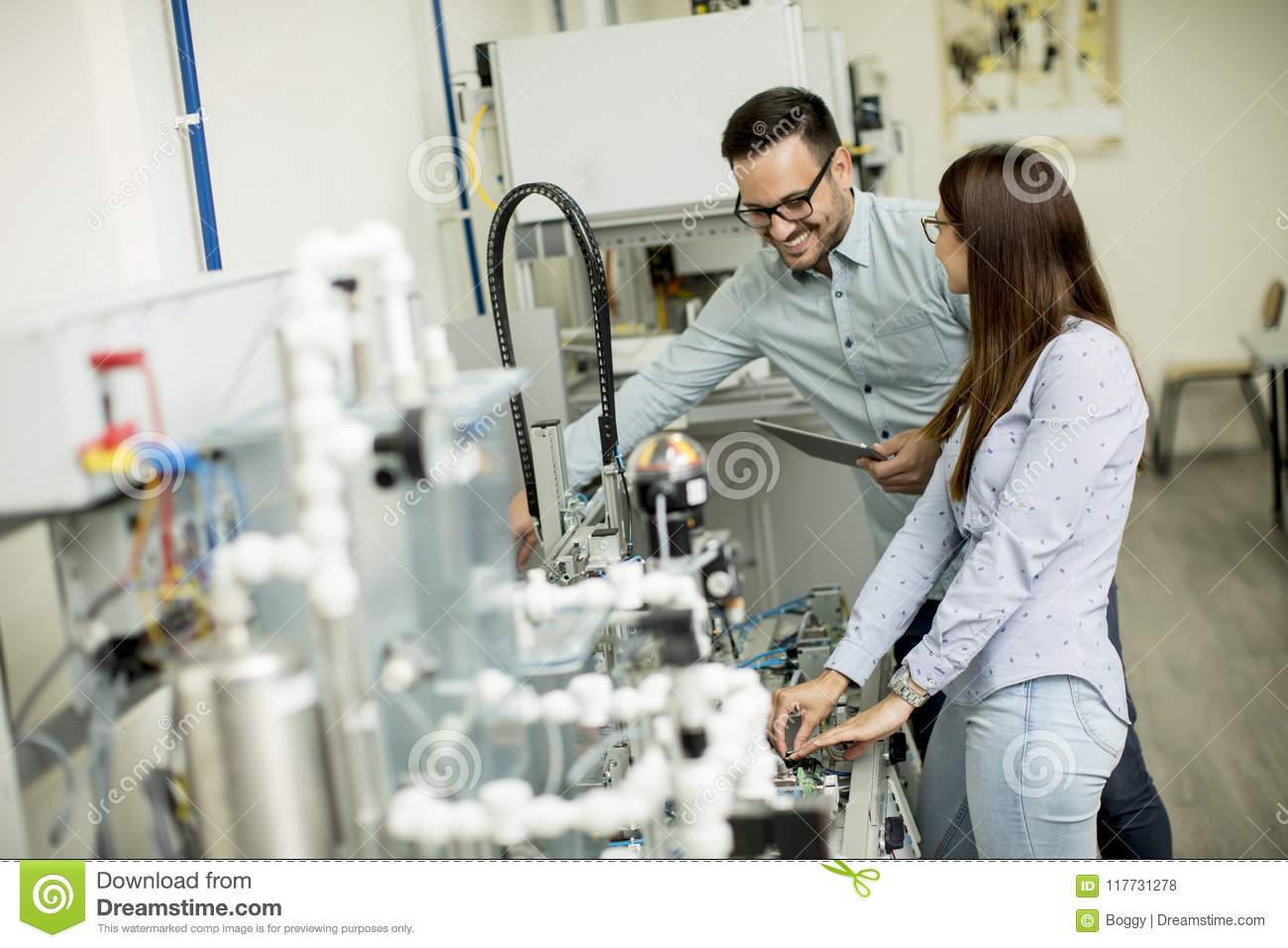 Young Couple Of Students Working At Robotics Lab Stock Photo Image