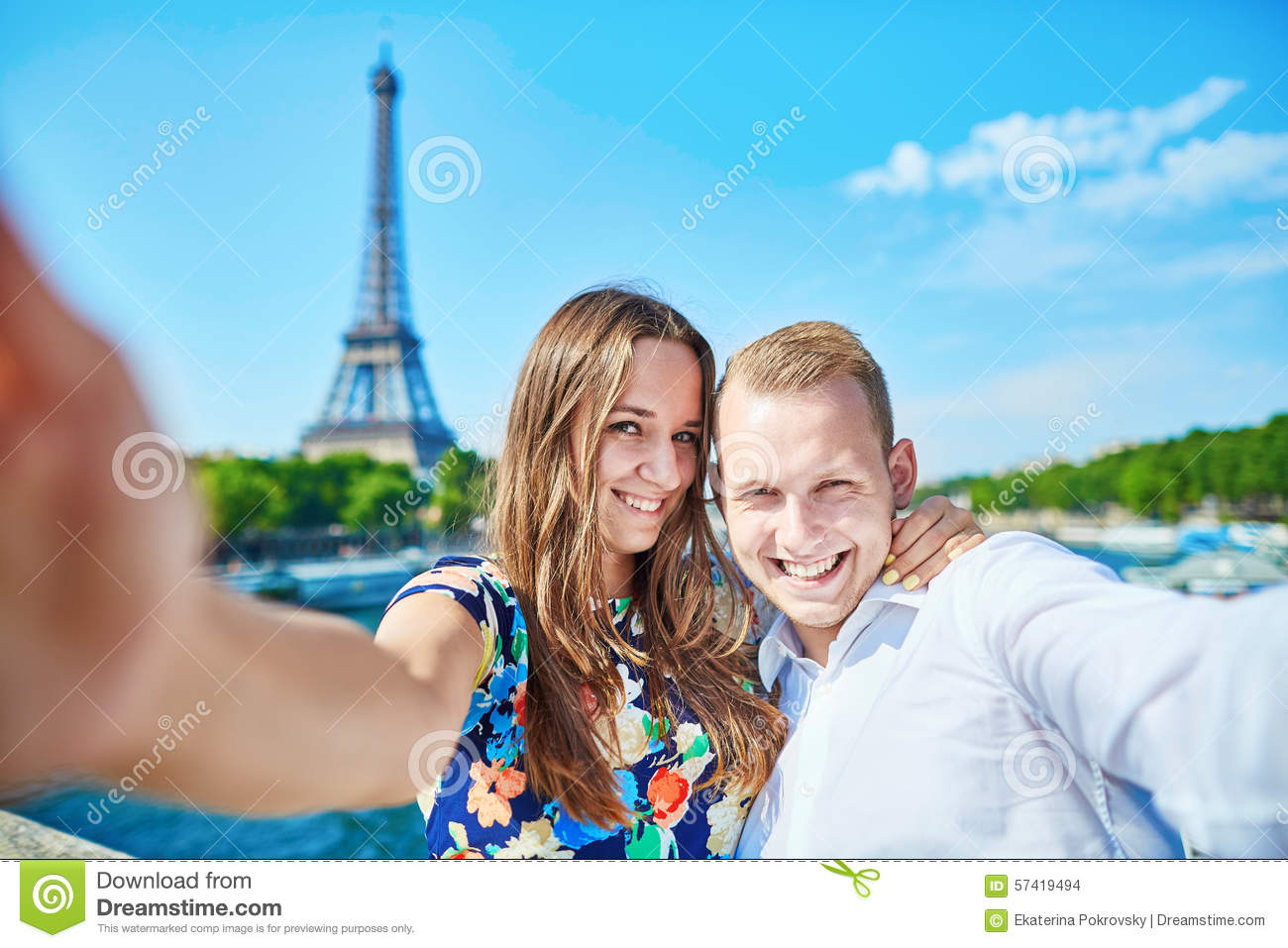 Young couple taking selfie in Paris, France
