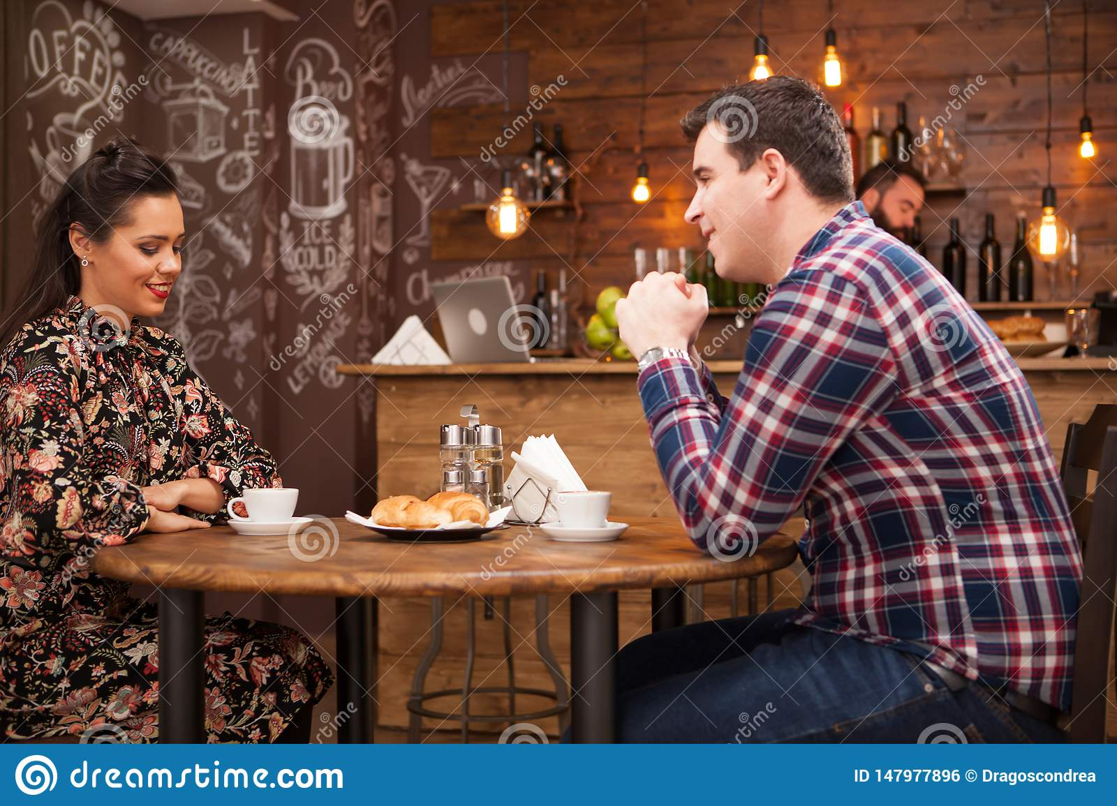 Young couple talking about the future in a cozy vintage pub.
