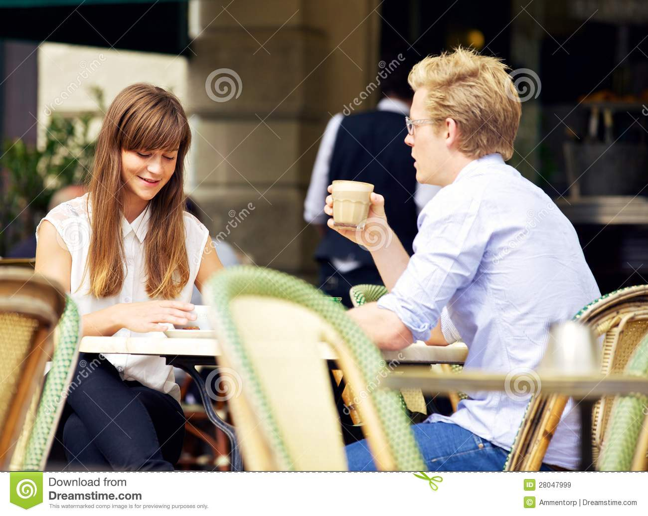 Young Couple Talking Over A Cup Of Coffee Stock Image