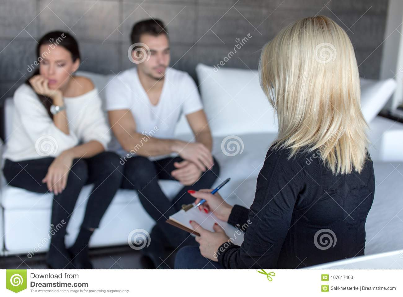 Young Couple Therapist Making Notes On Clipboard Indoors Stock Image
