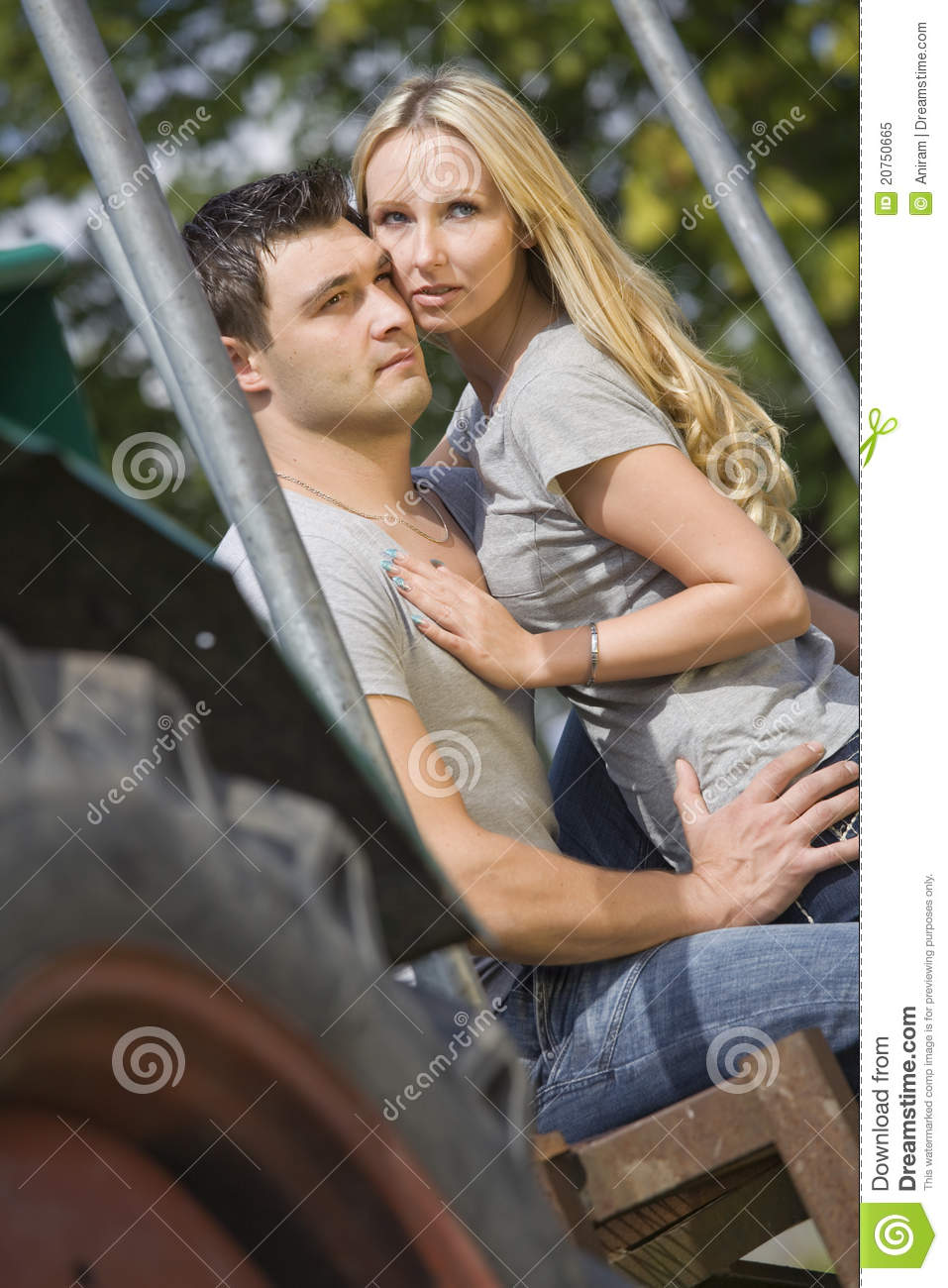 Couple On Tractor : Young couple on tractor royalty free stock photo image