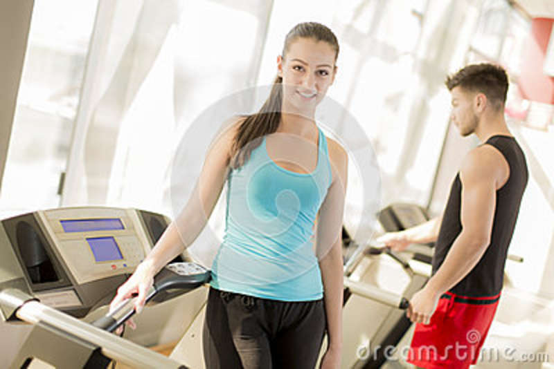 Young couple training in gym