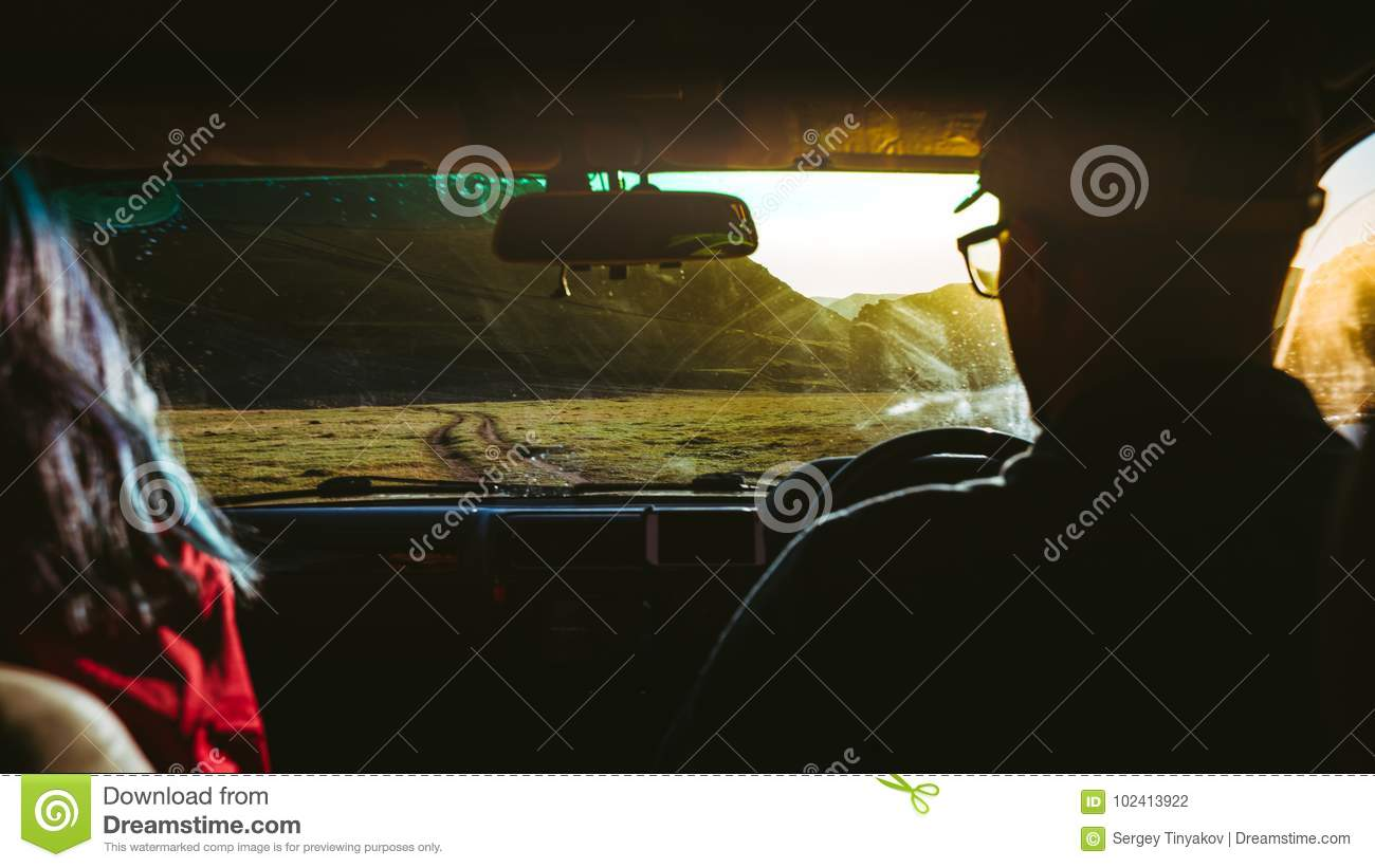 Young Couple Traveling In Car, Rear View. Road Trip Adventure Concept