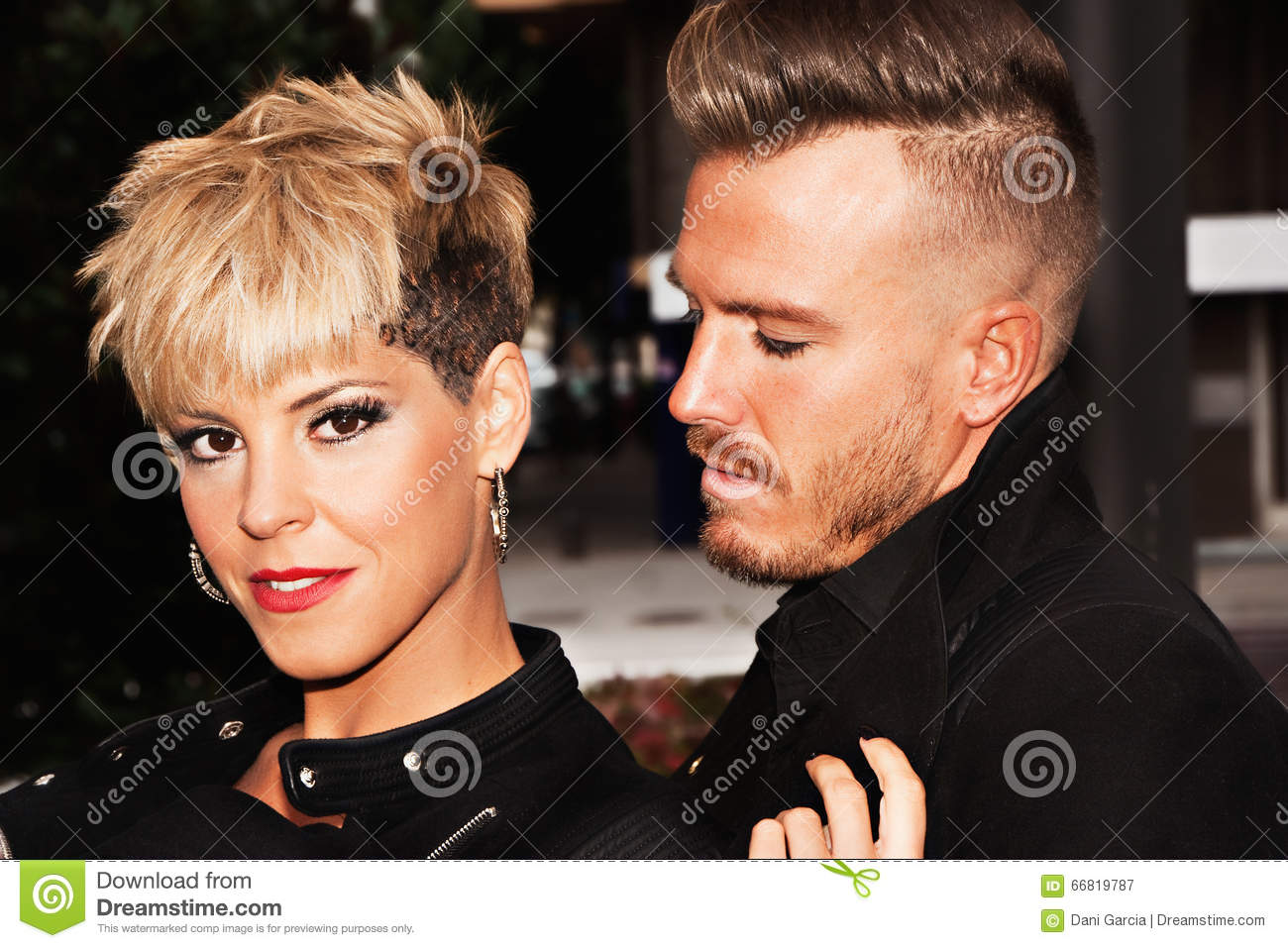 young couple with trendy hairstyles. stock image - image of jeans