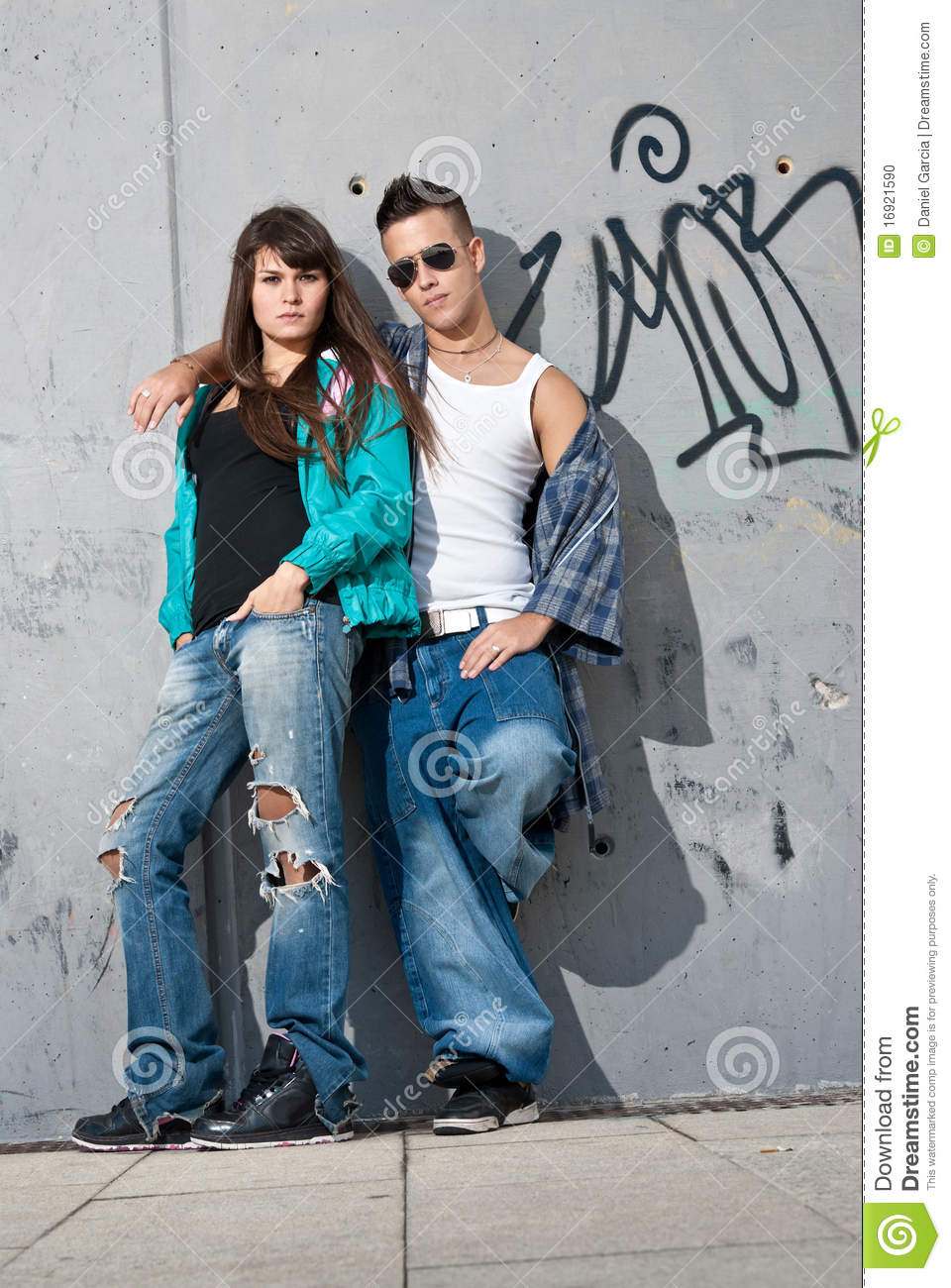 Young Couple Urban Fashion Standing Portrait Wall Stock