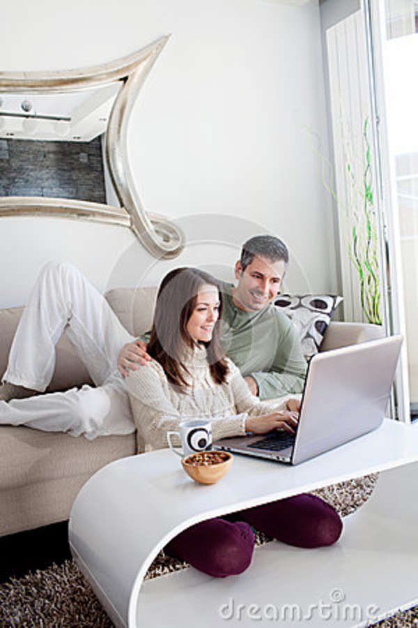 Young couple using laptop stock photo image 36862400 for Living room ideas for young couples