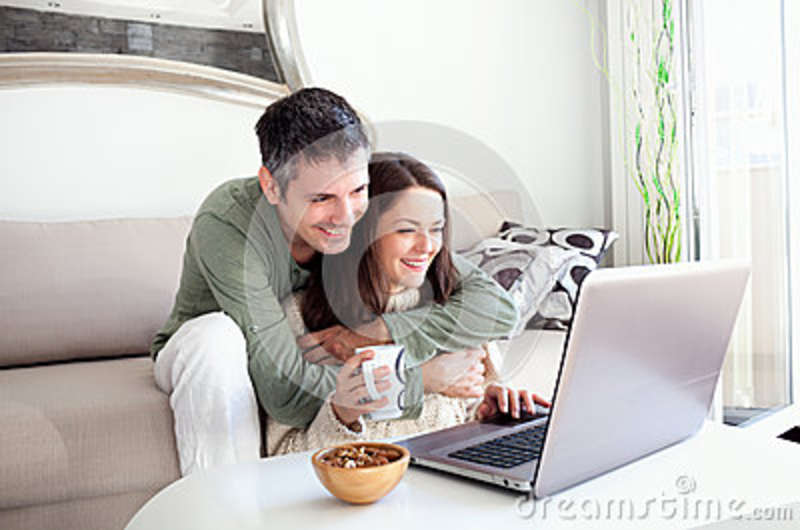 Young couple using laptop stock photo image 36862450 for Living room ideas for young couples