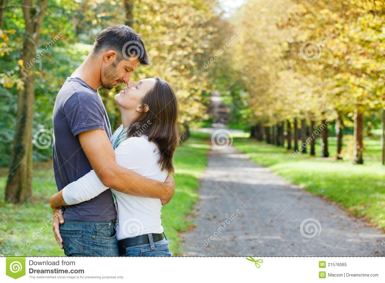 Royalty Free Stock Photo  Young Couple Walking in autumn parkYoung Couple Walking In The Park