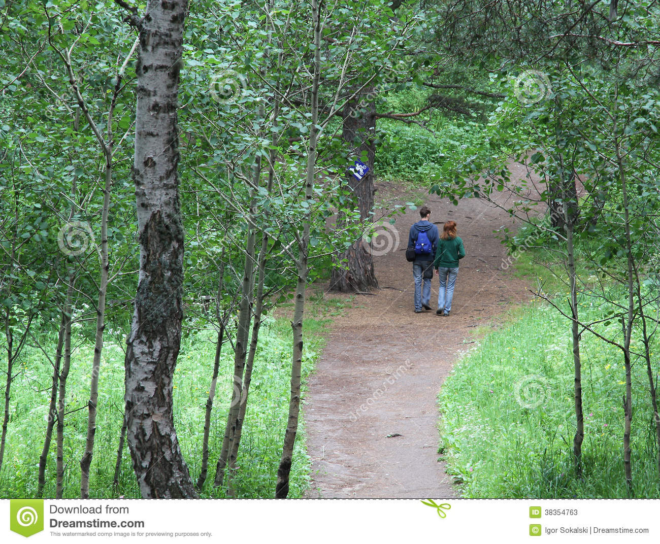 Young couple walking forest