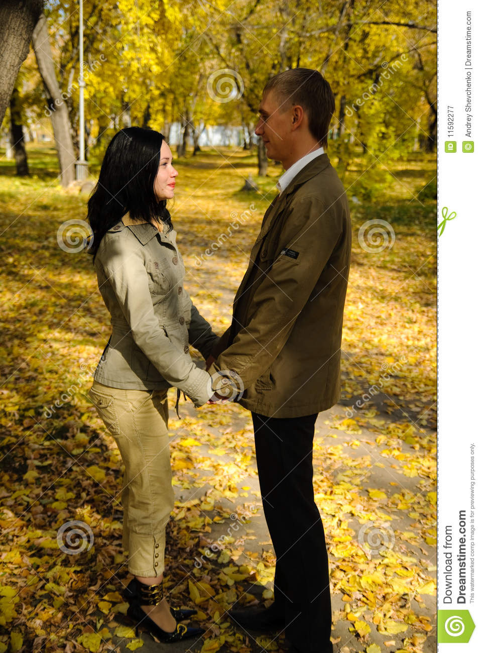 Royalty Free Stock Photography  Young couple walking in the parkYoung Couple Walking In The Park