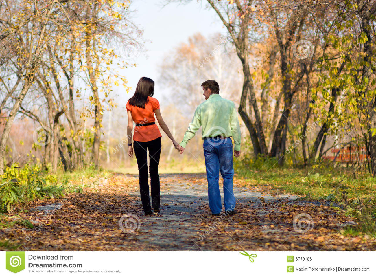 Royalty Free Stock Image  Young couple walking in the parkYoung Couple Walking In The Park