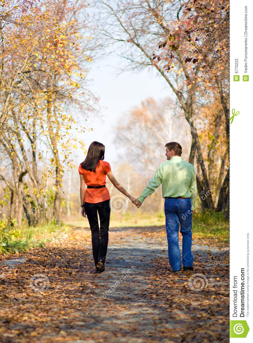 Young couple walking in the parkYoung Couple Walking In The Park