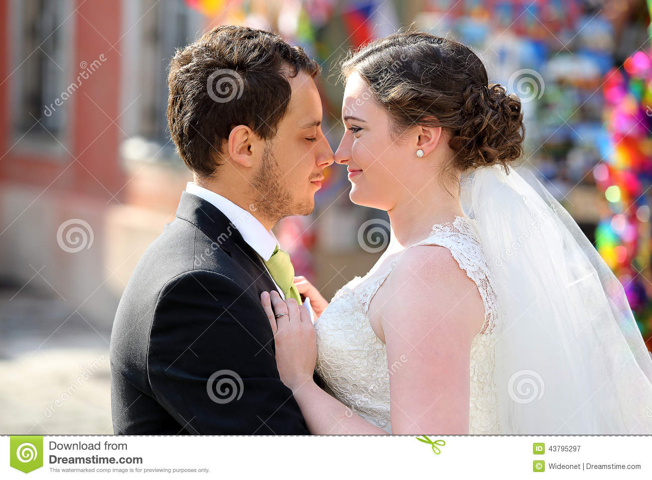 Young couple after wedding in a hug
