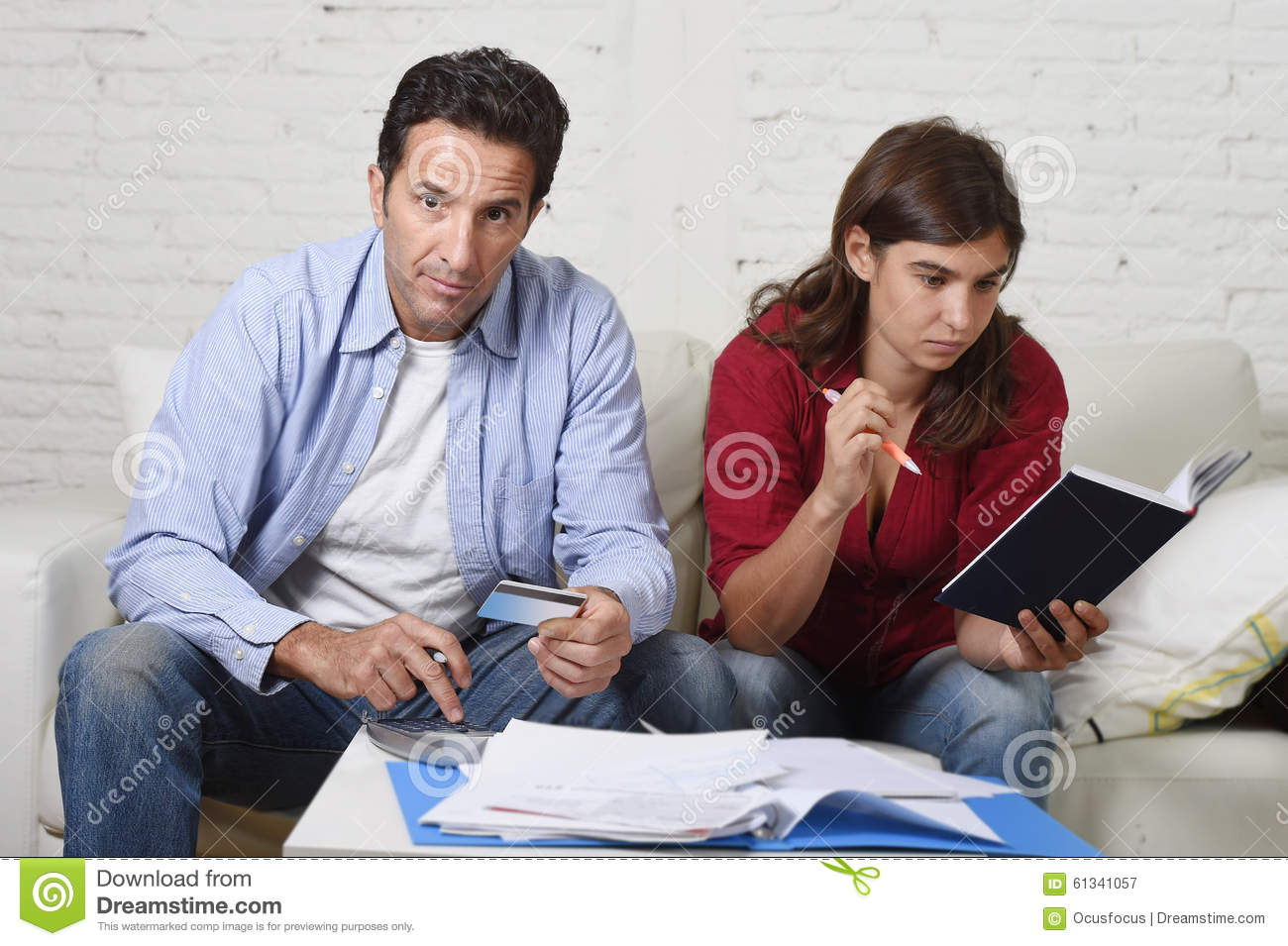 Young Couple Worried And Desperate On Money Problems At