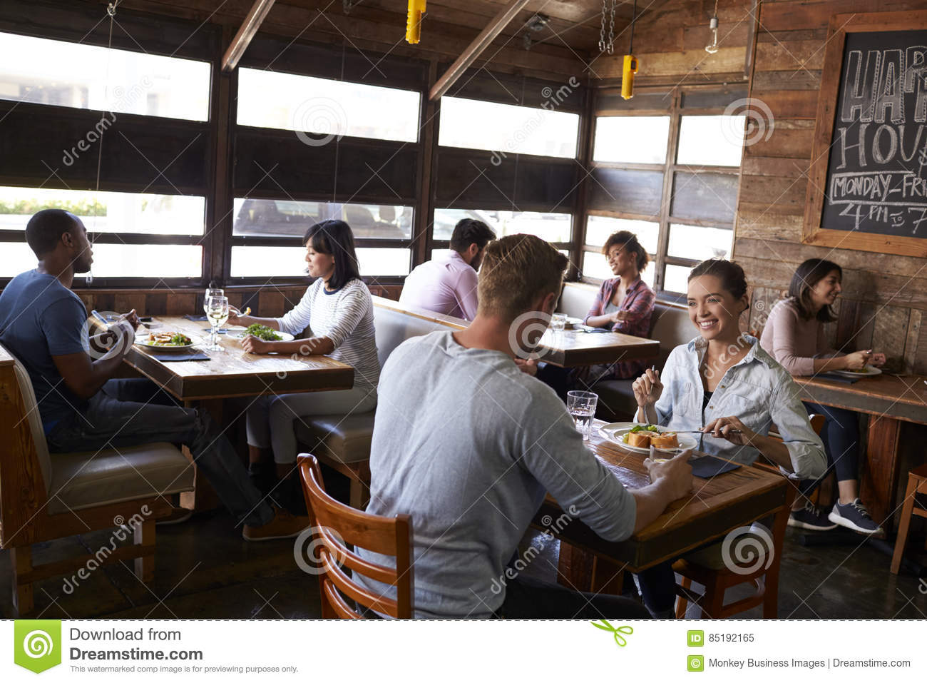 Young couples eating lunch relax in a restaurant
