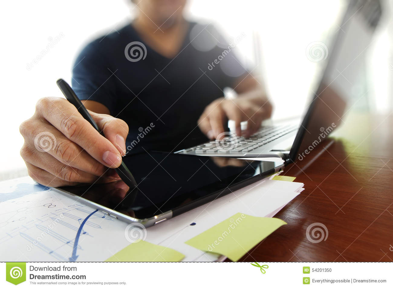Young creative designer man working at office