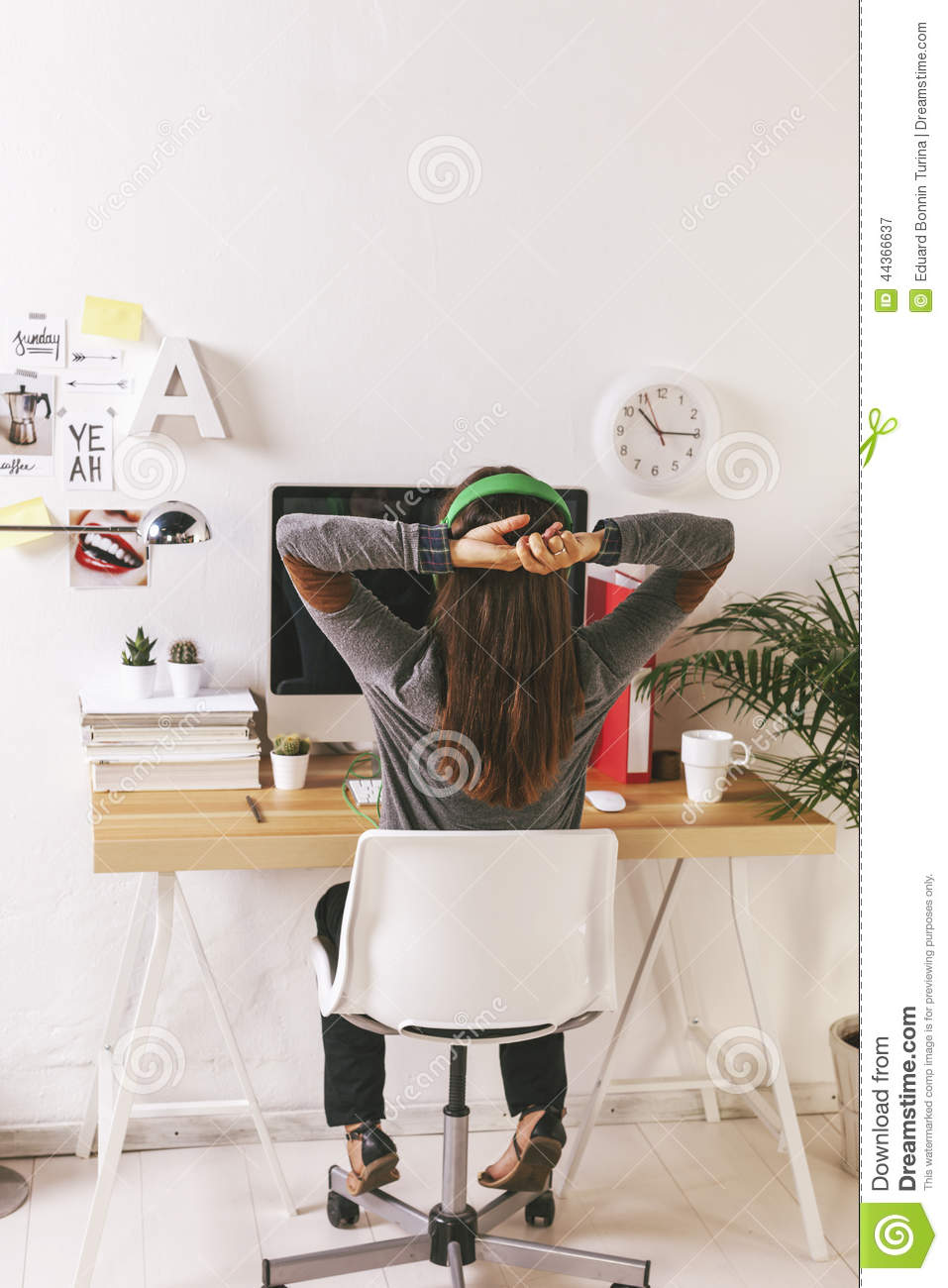 Young creative woman relaxing at office.