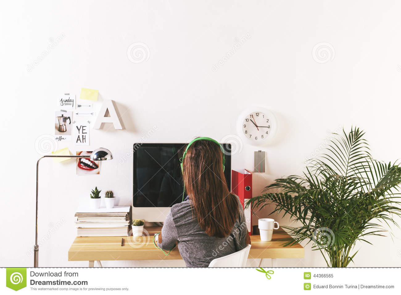 Young creative woman working at office.