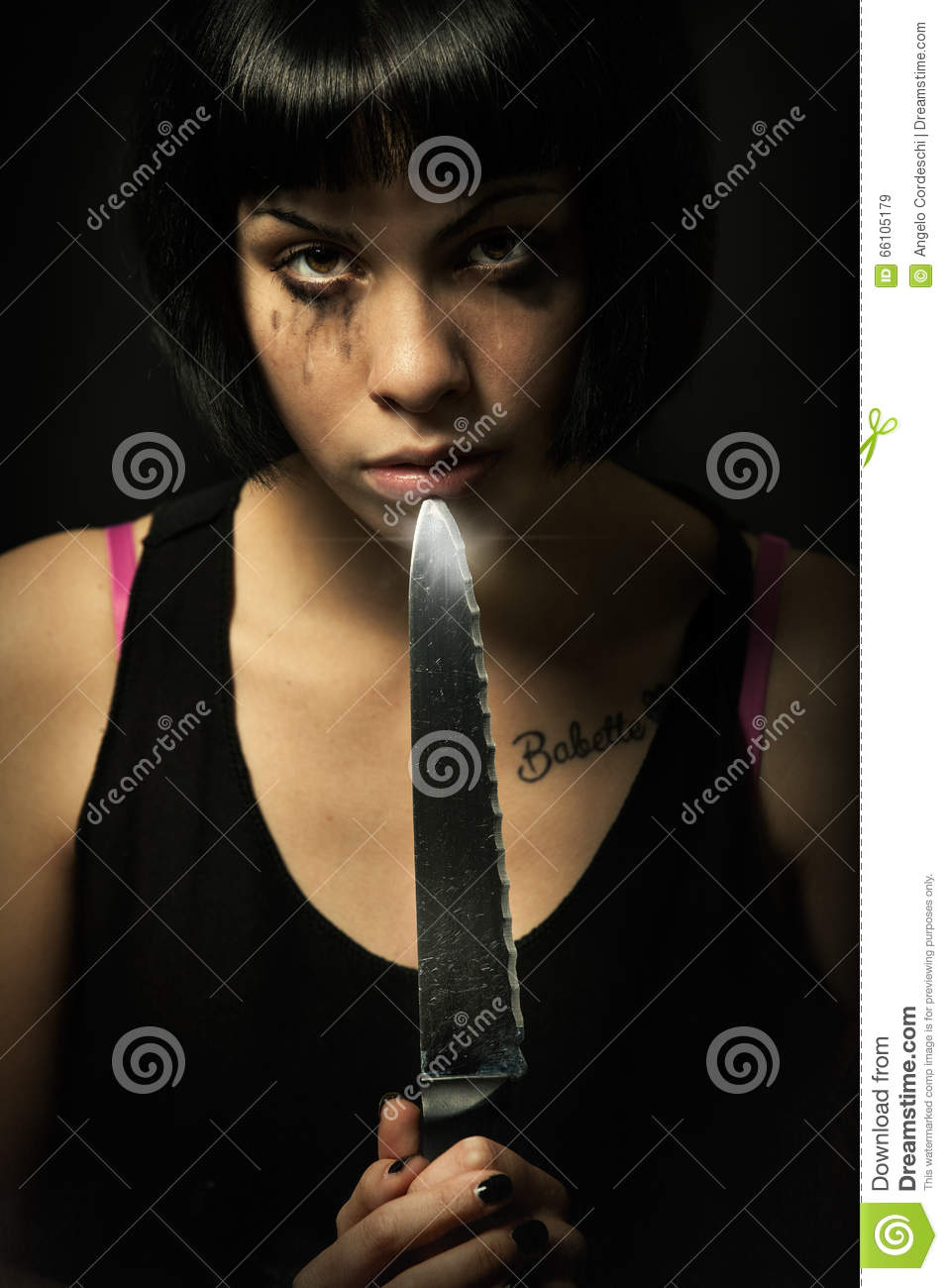 Young crying woman killer. Knife murder suicide. Crazy girl
