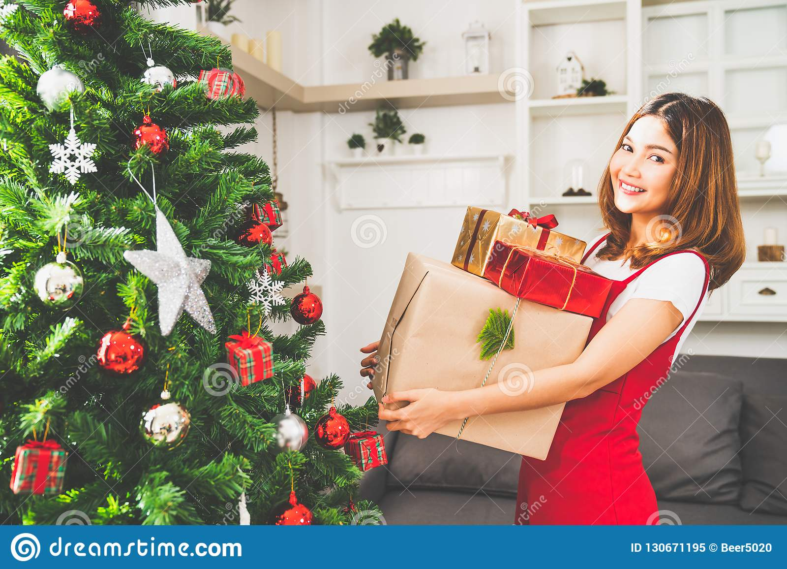 Young Living Christmas Tree.Young Cute Asian Girl Holding X Mas Present Boxes Christmas