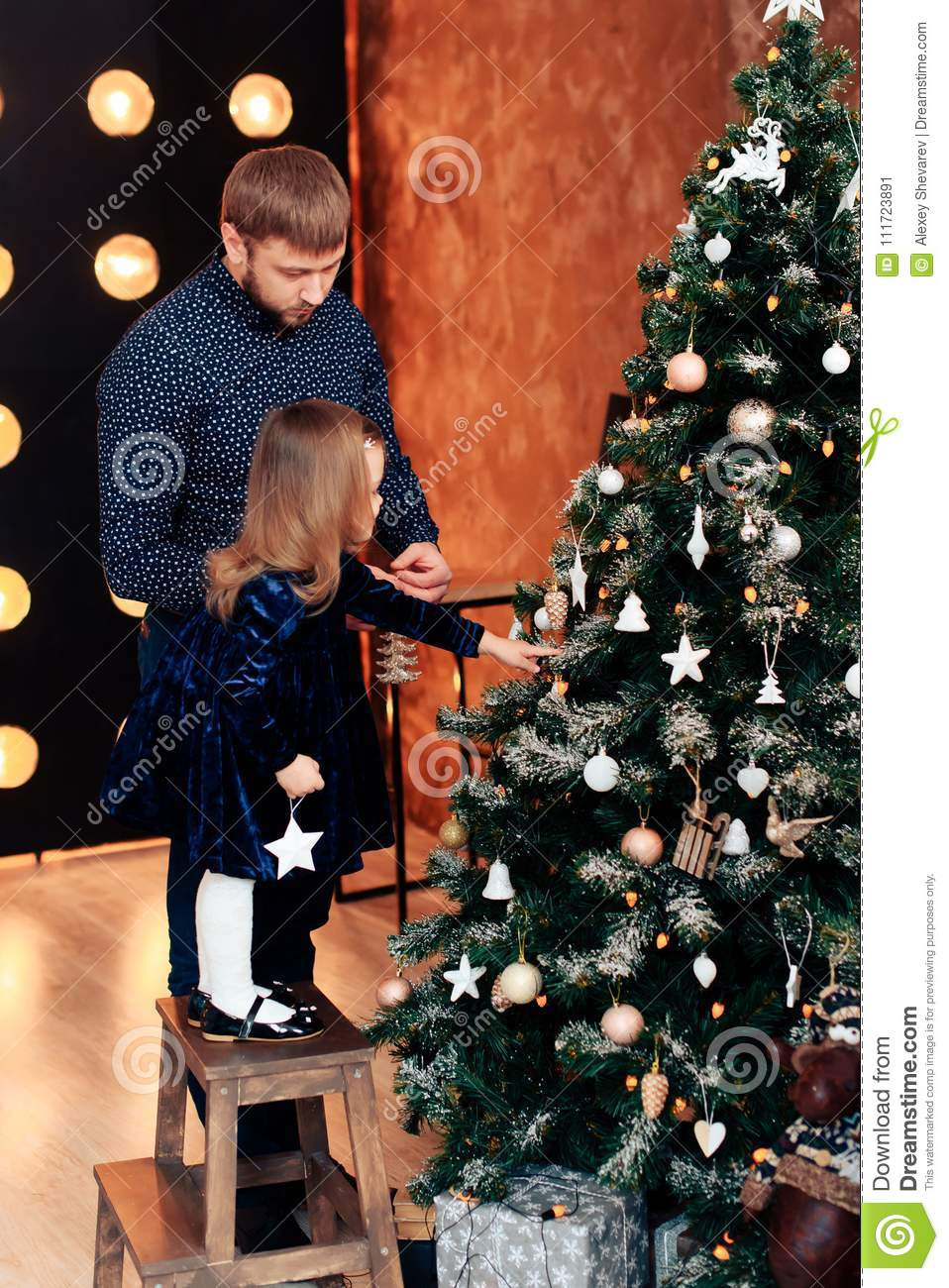 download young dad and little daughter in the new year decor with gifts stock image