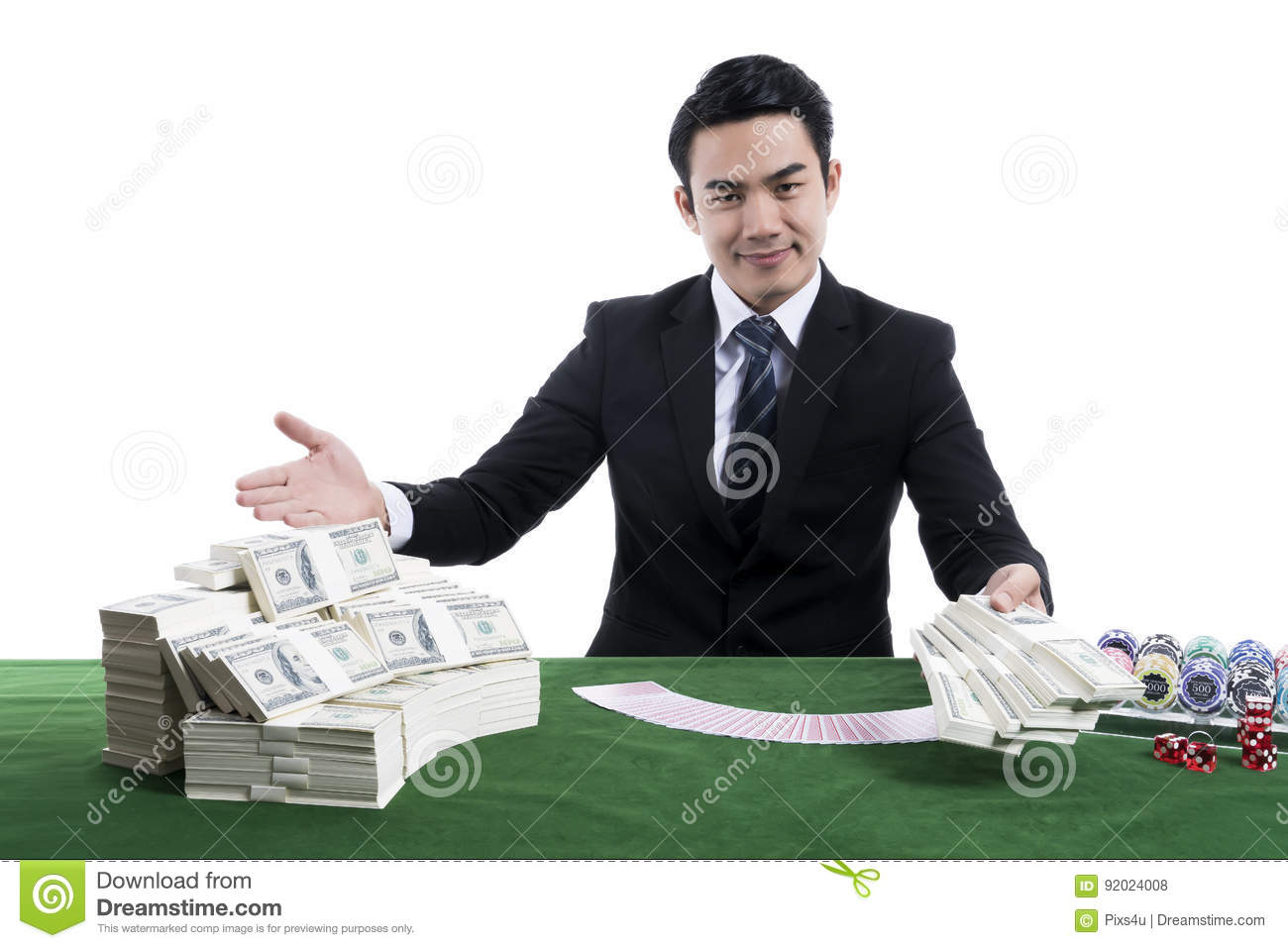 The young dealer holding banknote with gesture inviting and gambling devices on green table